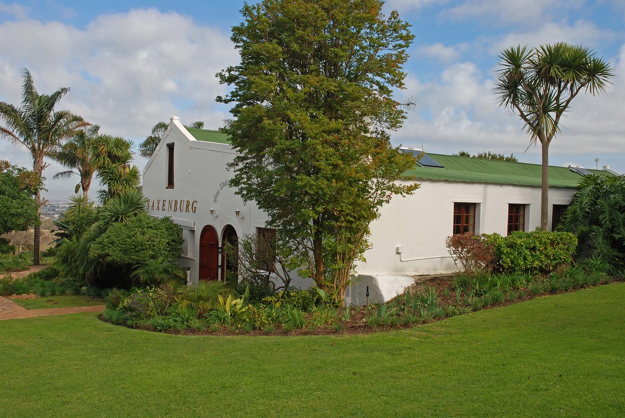 Saxenburg Wine Estate tasting room<br /> <br /> As we entered the beautifully maintained Cape Dutch estate, which dates back to 1693, we saw a variety of wildlife, including zebra, ostrich, springbok and blue wildebeest – a sneak preview of our upcoming safari in Kgalagadi Transfrontier Park. We sampled several wines and although the estate is known for its award winning shiraz, it was not a big hit with our group. We left with bottles of sauvignon blanc, merlot and the blend instead.