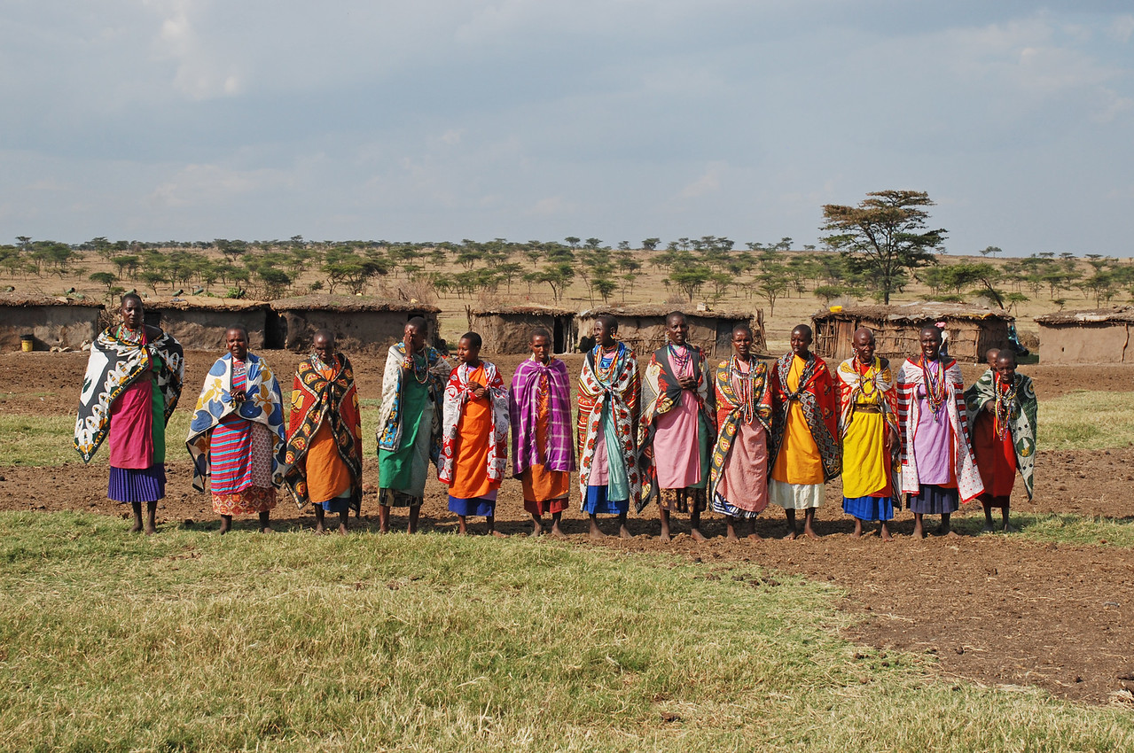 ← The women of Maendeleo greet us with a song<br /> <br /> Visiting Maendeleo Village in the Mara North Conservancy and seeing first hand how the Masai live - it was a fascinating and memorable encounter.
