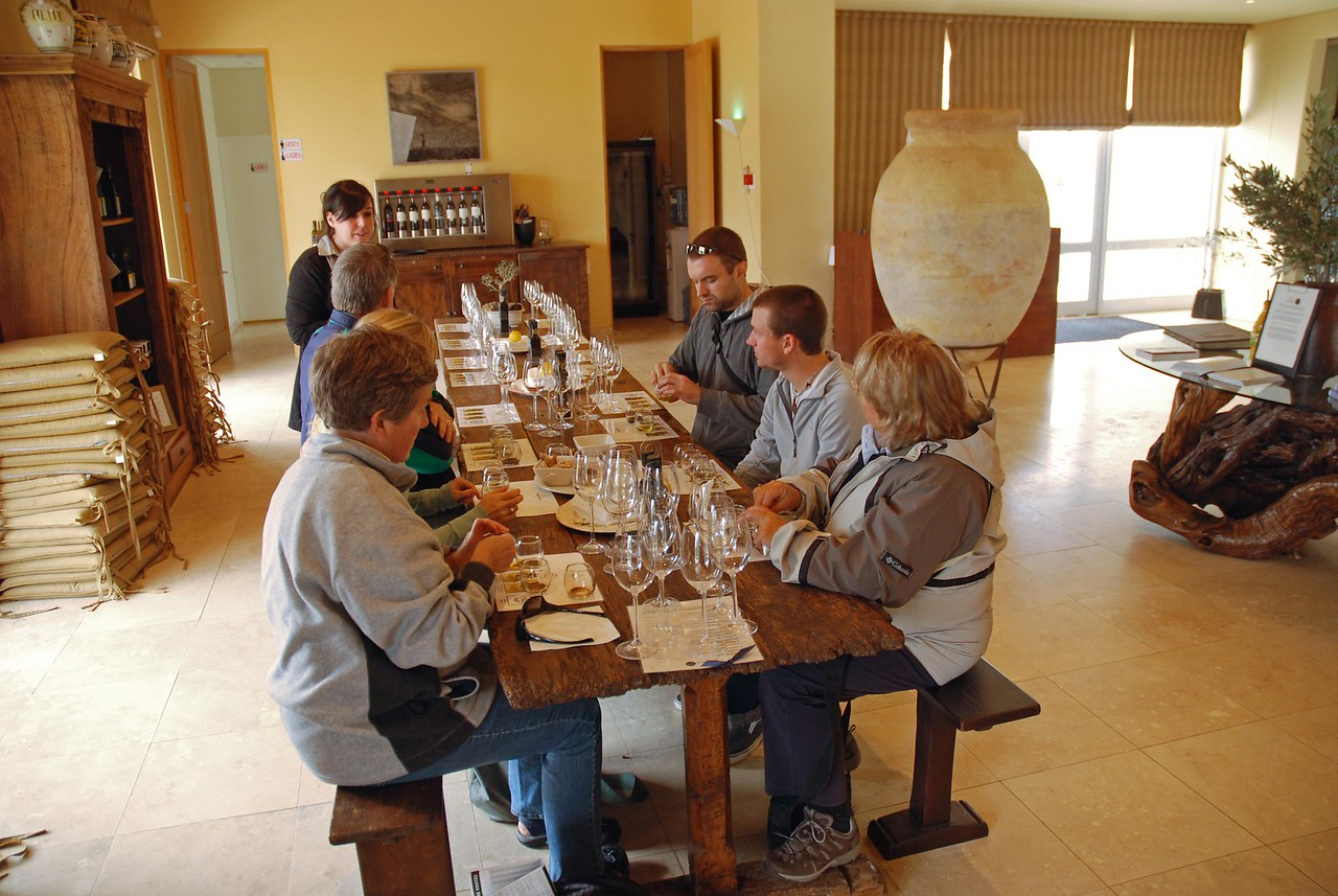 Sampling olive oil and balsamic vinegar at Morgenster<br /> <br /> In the tasting room, each of us had four small glasses placed in front of us, with three containing different varieties of extra-virgin olive oil, and the fourth holding a sample of the estate's balsamic vinegar. We were instructed to sip each in turn, after first warming the contents of each glass in our hands. The lemon infused (a lovely citrus aroma and flavour) and white truffle enhanced (think mushrooms and garlic - Robert complained that he wasn't able to get the taste of garlic out of his mouth for the rest of the day – it is strong!) olive oils were delicious, as was the balsamic vinegar (three years in a wooden cask does wonders for the flavour), and we purchased some of each to take with us on safari.