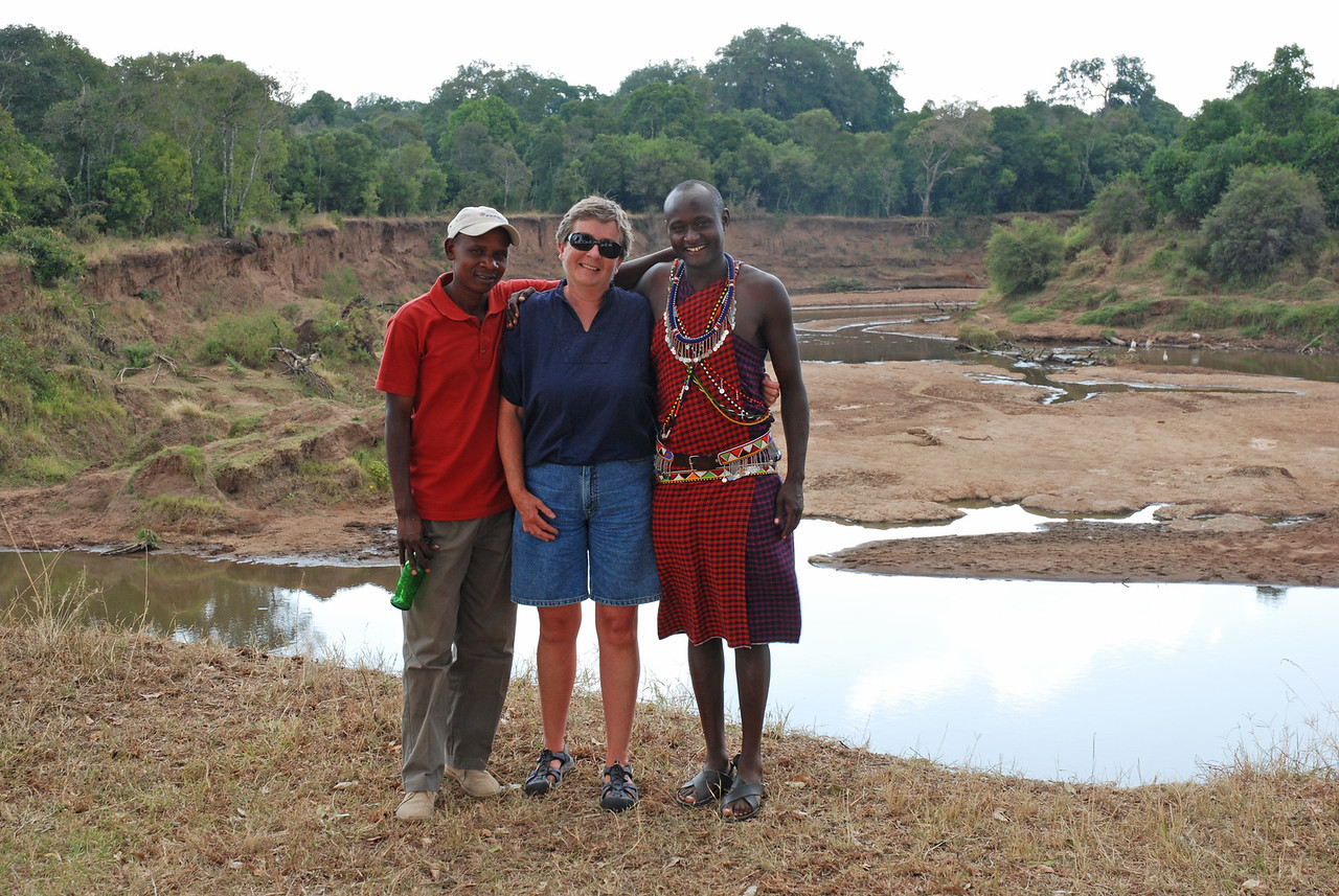 Robin with Jonathan (r) and Kimanzi of Serian Camp, Mara North Conservancy →<br /> <br /> Our day in the Mara with our guide, Jonathan, and driver, Kimanzi, from Serian Camp - they found us a leopard, a cheetah, 16 lions and so much more. Jonathan was a very knowledgeable guide and it was Kimanzi's driving skills that enabled us to track the leopard through the dense bush.