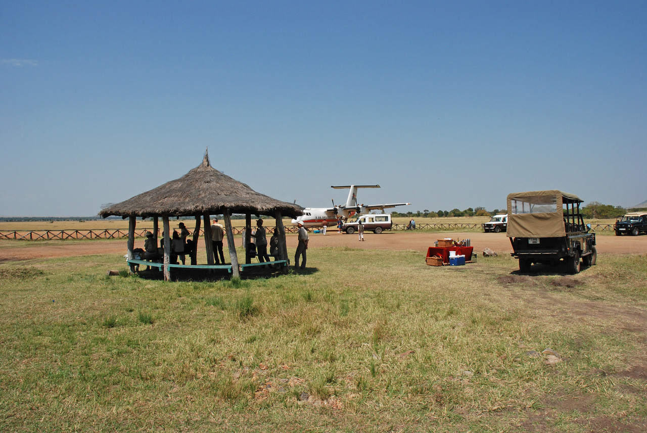 Kichwa Tembo airport →<br /> <br /> The airport at Kichwa Tembo consisted of an open-sided, thatched rondavel with benches. There were a surprising number of people waiting for airplanes, and a number of guides in safari vehicles either seeing guests off or waiting to greet new arrivals.