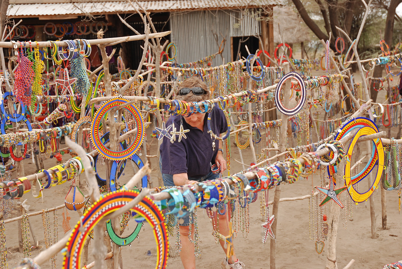 Robin shopping for Masai jewelery near Tarangire National Park in Tanzania →<br /> <br /> The markets - great shopping and a fantastic way to meet the local people. We stopped at many and were often the only tourists there.<br /> <br /> The Masai market in Arusha - good quality, great selection and excellent prices.<br /> <br /> The two markets just outside of Tarangire National Park - run by local Masai women in support of their communities.