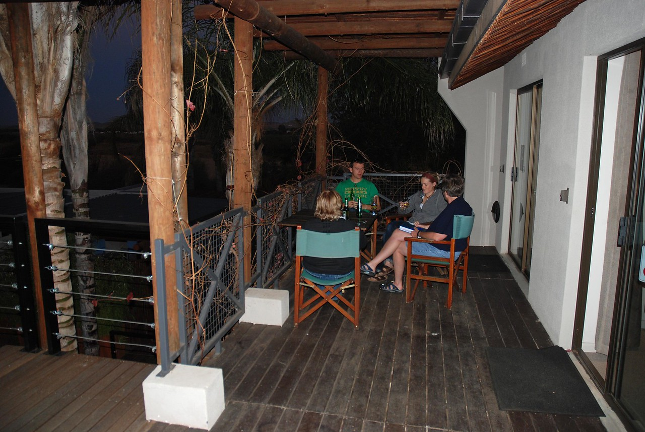 Craig, Kathy, Robin and Laura enjoying a drink on the balcony at Brown's Manor<br /> <br /> We enjoyed a night of luxury before heading into the national park to camp. After a drink on the balcony overlooking the river, and dinner in town, we headed to bed, anxious to be up early and get a quick start in the morning.