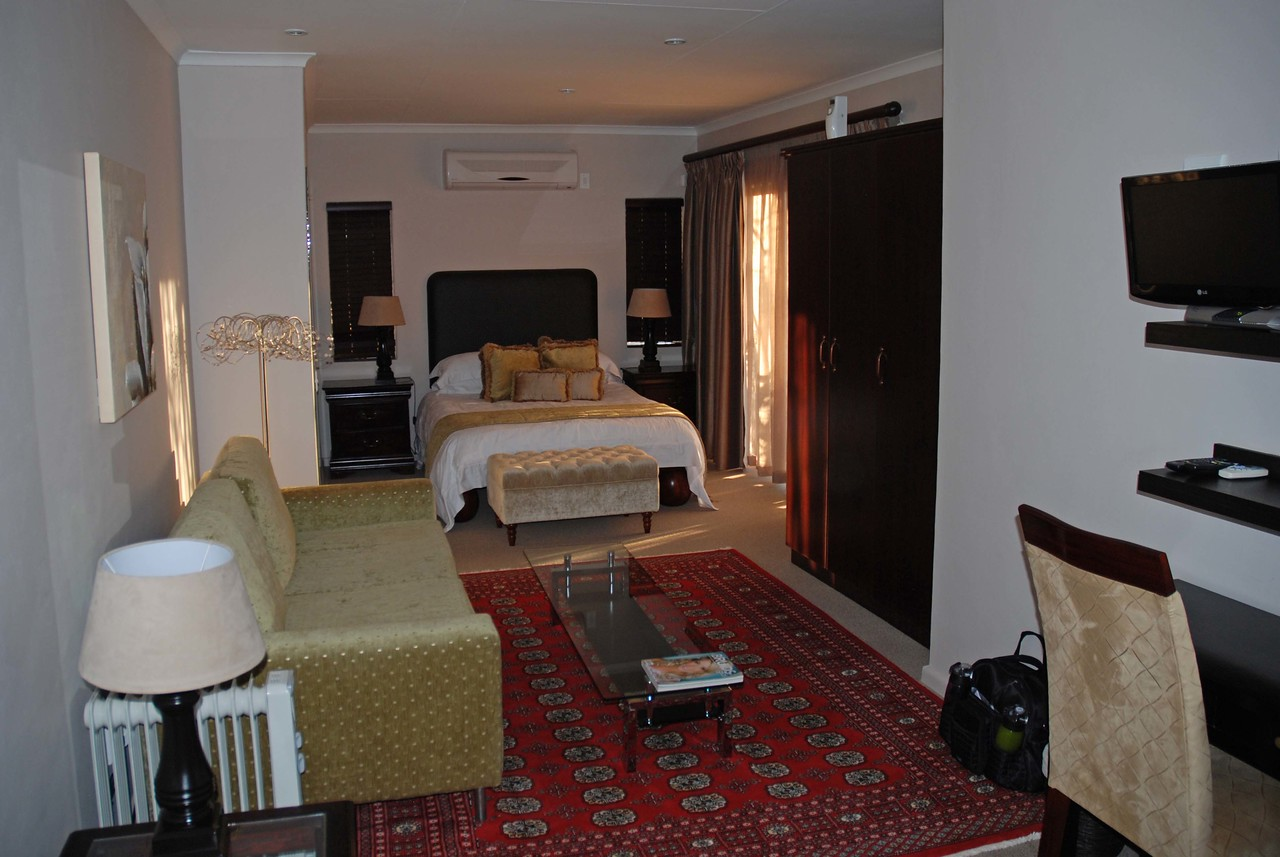 "Our room at Brown's Manor<br /> <br /> We were greeted in the parking lot by Bonnie, a shy man with impeccable manners, and Heidi Brown, the owner of the guest house. The rooms were beautifully decorated, including the room that Graham stayed in, which was the ""pilot's room."" This room is normally reserved for pilots, who are flying rich guests around the country in a private aircraft on an exclusive safari."