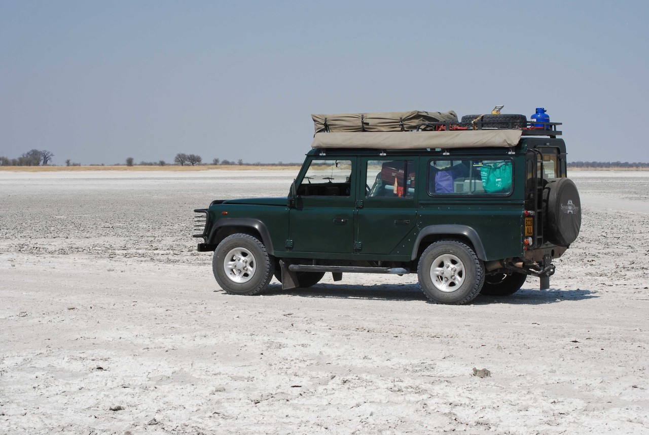 """The Land Rover<br /> <br /> We were no sooner out of the car when we were greeted by Albert Michau, the Safari Drive representative in Botswana. If Albert was surprised that we had managed to arrive so close to the appointed hour, he didn't say so. I was impressed with his punctuality, as we have experienced """"Africa time"""" on many occasions. Albert suggested that we relocate both vehicles behind the Avis building to an area that was fenced and secure, where we could have the vehicle briefing and transfer our belongings from the Yaris to the Land Rover. <br /> <br /> That done, Albert began by reviewing a notebook that he had handed to us. It contained our day-to-day itinerary, driving guidelines with detailed route information, the vehicle registration, a letter of permission from Safari Drive for us to drive the vehicle, emergency contact numbers for Safari Drive in Botswana and our permit to enter the national parks and reserves, which included our campsite reservations. Albert also reviewed with us the """"Southern Africa Trip Book"""" that Safari Drive had sent to us several months earlier. It contained all of the general information that we needed to self-drive through Botswana and covered topics such as clearing customs and crossing borders, safety and security, the vehicle and all of its equipment from the tire inflator to the Engel fridge, off-road driving tips, what to do with rubbish when in the parks, tips for cooking over an open fire, shopping, fuel, money, national park fees and rules, and how to use the satellite phone should we get into trouble. Robert and I had reviewed this book thoroughly before leaving Calgary and had a list of questions for Albert, which he answered patiently."""