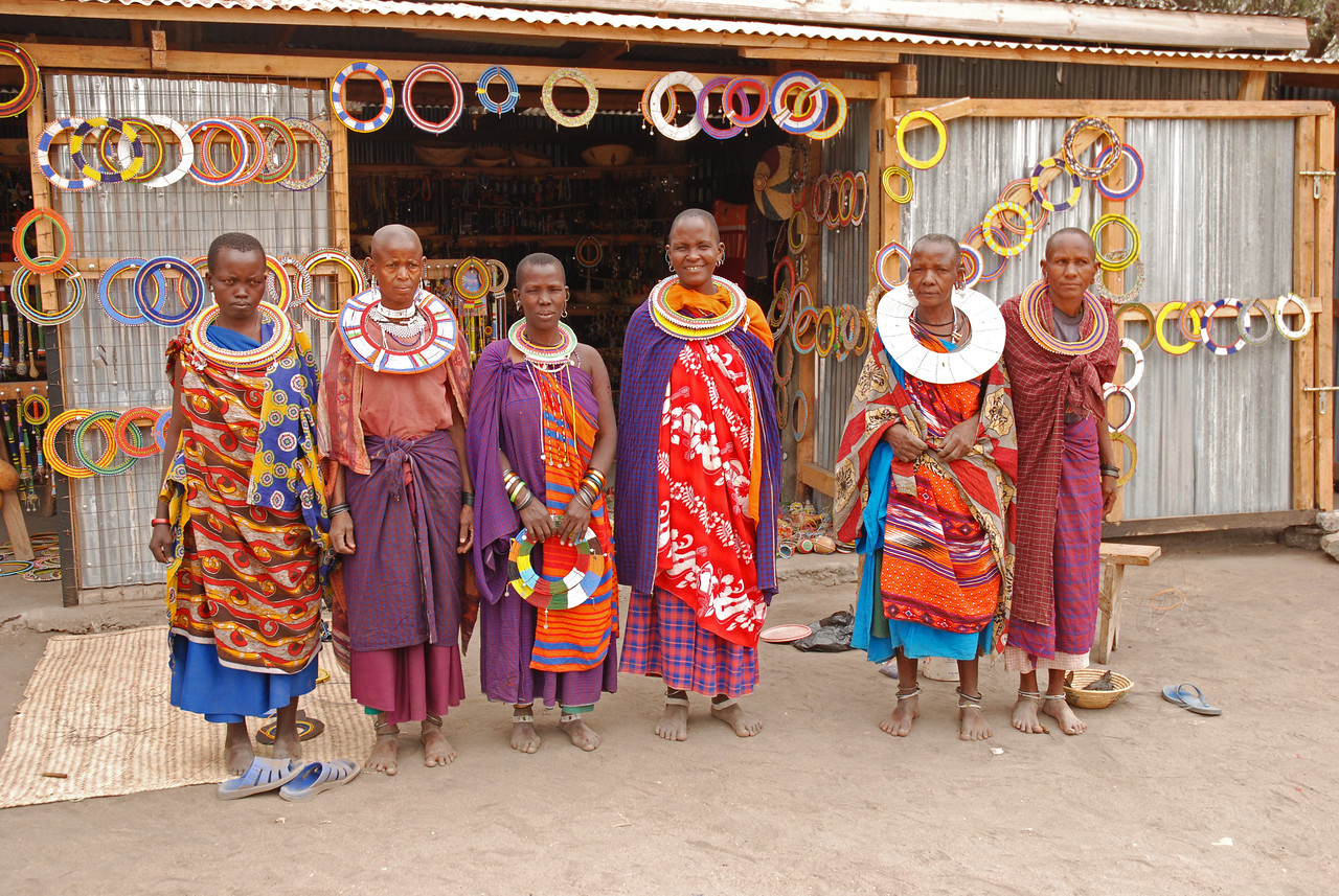 """These friendly women in rural Tanzania were delighted when Robert asked them in Maa for permission to take their picture - """"Aosh empicha?"""" →<br /> <br /> The opportunity to interact with the people in the rural villages of Tanzania and Kenya. One advantage of self-driving is that it forces you to be independent and interact with the local people and not to rely on your guide. We were warmly received wherever we went, even in the most remote locations, where we looked as though we had been beamed in from another planet.<br /> <br /> Returning to Serian Camp from the Mara Triangle, we became lost in the village of Mararianda. We turned onto what we thought was the road north only to discover after 50m or so that it was in fact either a game trail or a walking path. We went in circles trying to find our way to the road, much to the amusement of the villagers who appeared in droves to watch. With many gestures and much laughter on both parts, the villagers helped us find our way.<br /> <br /> Driving across the Kenyan/Tanzanian border at Isibania/Sirari - complete and utter chaos but an experience we wouldn't have missed."""