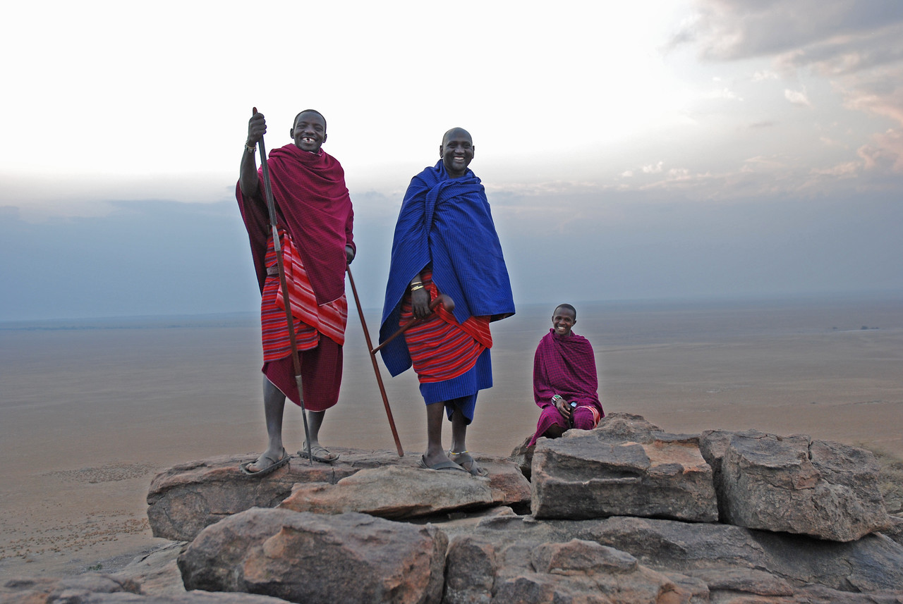 Our Masai guides at Olduvai - (l to r) Rayani, Papai and David - on the kopje near the camp at sunset →<br /> <br /> <br /> The opportunity to interact with the Masai in a non-touristy setting at Olduvai Tented Camp in the Ngorongoro Conservation Area in Tanzania - particularly the walk at sunset.<br /> <br /> The sound of the cow bells as the Masai herders led their cattle through the Ngorongoro highlands.<br /> <br /> The reaction of the Masai to our feeble attempts to speak their (Maa) language. They were so gracious, and many took the time to teach us more words and help us with our pronunciation.<br /> <br /> Our impromptu chat with Ben and Peter, two Masai warriors from the village of Ilkinye, on the road just north of Oloololo Gate in Kenya.