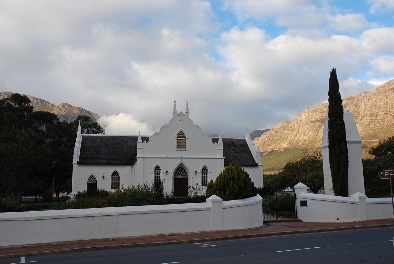 The Dutch Reform Church on the main street of Franschhoek, one of many lovely buildings in the town<br /> <br /> By the time we left the Waterford Estate, it was late afternoon, and having had nothing to eat since breakfast other than chocolate and olives, we were feeling a bit peckish. As a result, we ended our tour of the Winelands with a stop in the town of Franschhoek, where the seven of us devoured six large pizzas at Col'Cacchio, a pizza chain in the Western Cape that produces unique and delicious pizzas. Our favourites were the Rustica (roasted butternut, gorgonzola and pumpkin seeds), the Autunno (caramelized onion, sundried tomatoes and smoked mozzarella) and the Brie (brie cheese, peppadews and onion). Also soooo good! After a very satisfying meal, we wandered the main street of Franschhoek, and purchased a few lovely souvenirs.