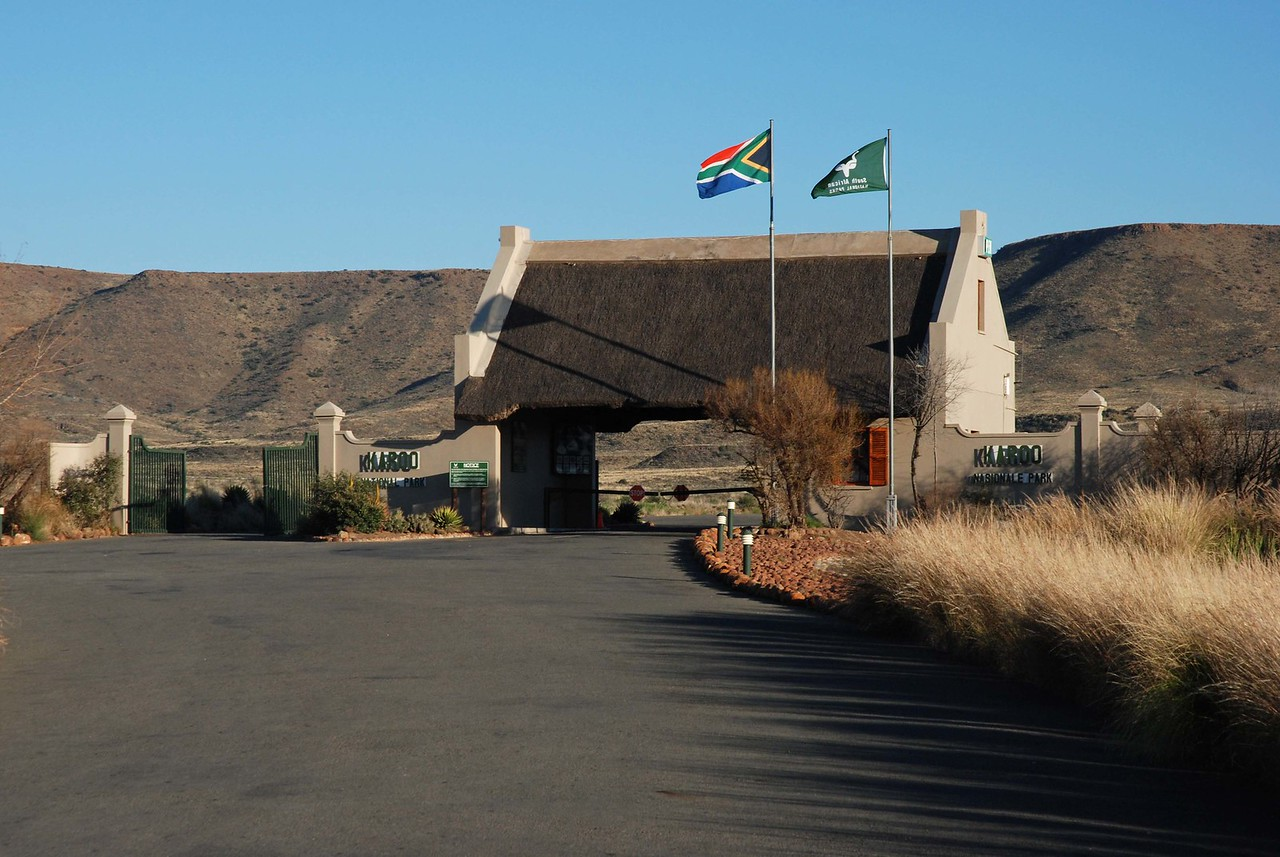 The entrance to Karoo National Park<br /> <br /> We arrived at Karoo National Park at 3:30pm. Once inside the park, we felt as though we were a million miles from anywhere, although we were actually within sight and just a few kilometres off the busy highway.