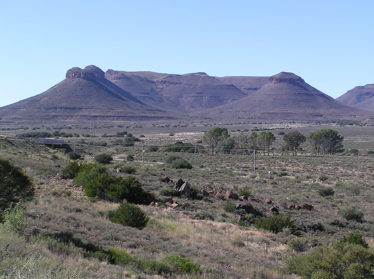 """The South African version of the Three Sisters<br /> <br /> We stopped briefly in Beaufort West for petrol (Rand 9.85/litre or CDN$1.23/litre for diesel) and then continued northeast along the N1 highway to the South African version of the Three Sisters - not quite as majestic as the Alberta version, but very pretty, flat-topped mountains nonetheless. Along this busy stretch of the highway, we passed several troops of vervet monkeys and signs warning of """"rots storting"""" – rocks falling!"""